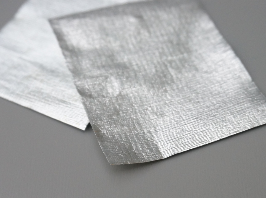 Layer your two pieces of paper or ribbon