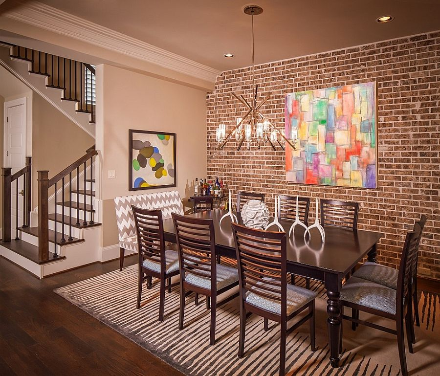 Layout and style of the brick turns the space next to the staircase into a fun dining space [Design: Jamestown Estate Homes]