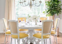 Light hues of gray and pops of yellow combine to create a sophisticated ambaince in the dining room 217x155 Trendy Color Duo: 20 Dining Rooms That Serve up Gray and Yellow