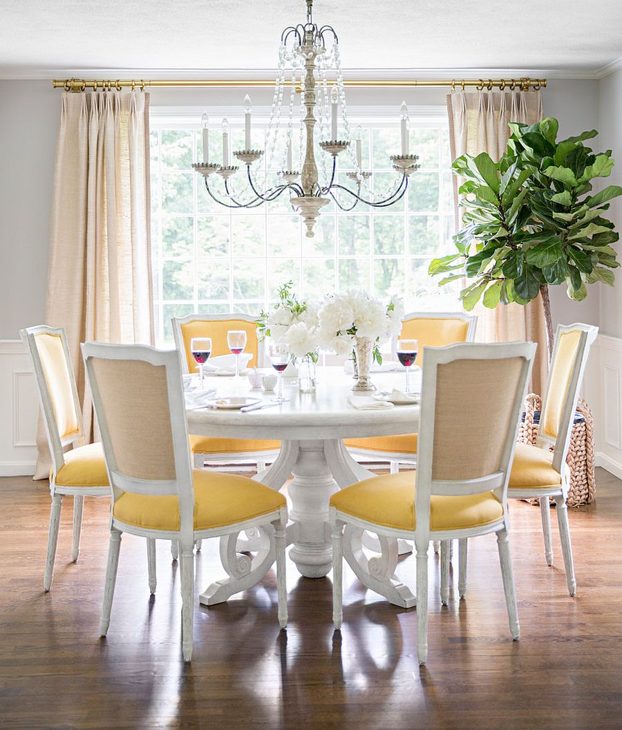 Light hues of gray and pops of yellow combine to create a sophisticated ambiance in the dining room [Design: McGrath II]