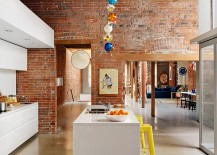 Lighting-and-bar-stools-add-color-to-the-industrial-kitchen-217x155