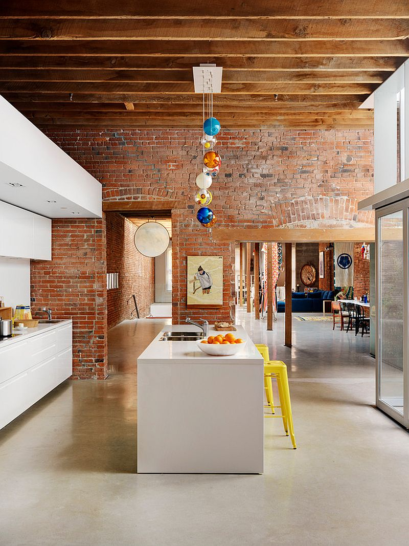 Lighting and bar stools add color to the industrial kitchen [Design: ReNew Design]