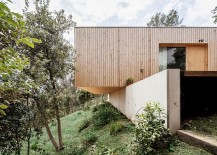 Lightweight-wooden-contruction-on-retaining-walls-creates-a-home-with-minimal-footprint-217x155
