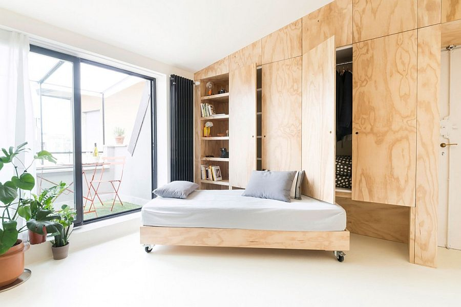 Living room couch that slides under the custom wooden unit
