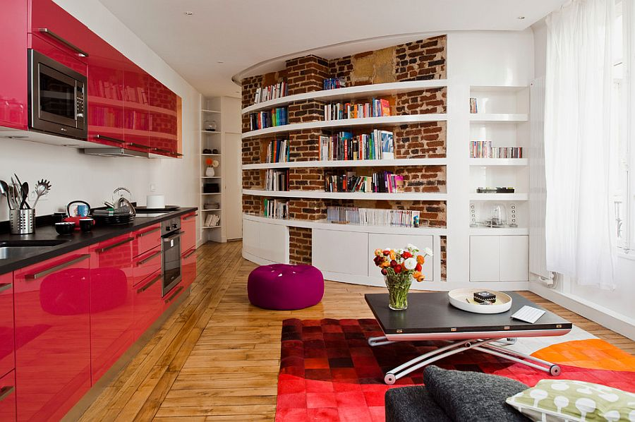 Living room with color, curved brick wall and chic coffee table [Design: Manuel Sequeira Architecte]