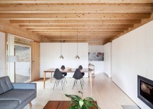 Living-room-with-white-walls-and-woodsy-ceiling-217x155