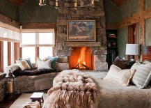Lovely stone wall fireplace and window seat enhance the woodsy cabin style of the bedroom 217x155 25 Bedrooms that Celebrate the Textural Brilliance of Stone Walls