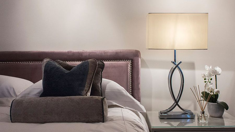 Luxurious bedding turns the small bedroom into a cozy delight