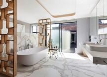 Marble-cald opulence of the lavish bathroom inside the London penthouse