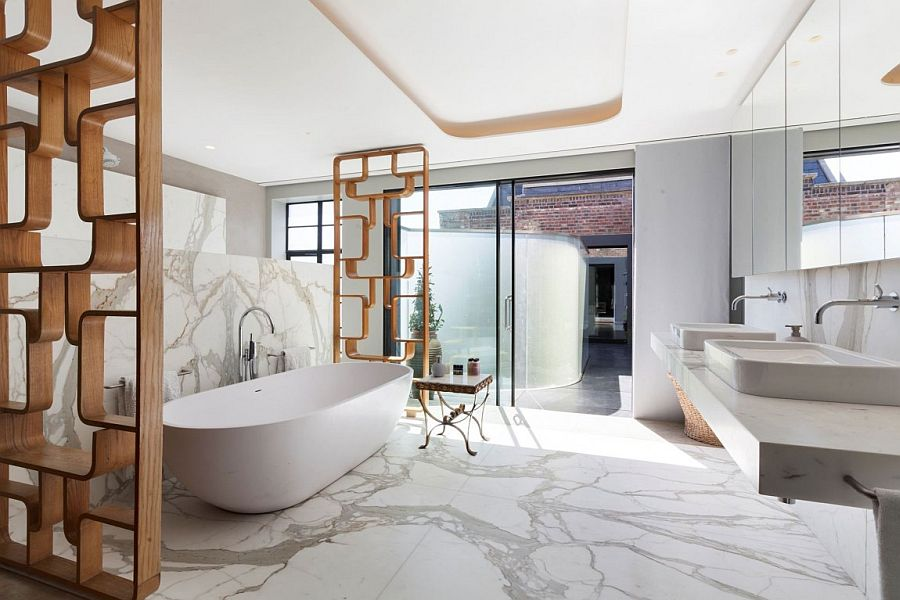 Marble-cald opulence of the lavish bathroom inside the London penthouse