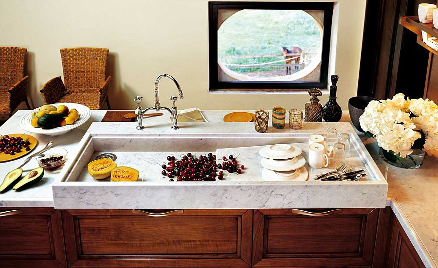 Marble countertop adds a touch of class to the exquisite luxury kitchen