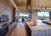 Marble kitchen island and wooden shelves for the contemporary kitchen