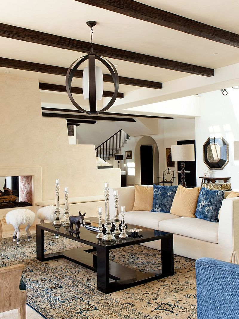 Mediterranean living room with a curated hint of black [Design: Brion Jeannette Architecture]