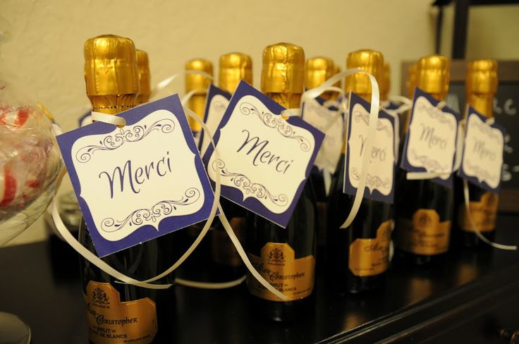 'Merci' favor tags on mini bottles of champagne