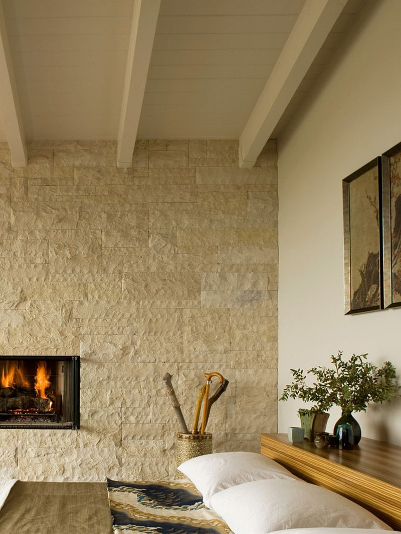 Bedroom stone fireplace -  Midcentury Bedroom With Natural Stone Backdrop And A Platform Bed Design Laidlaw Schultz Architects
