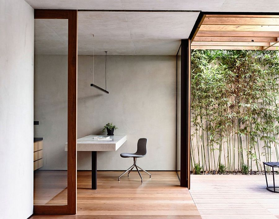 Minimal corner home office that opens up into the rear yard