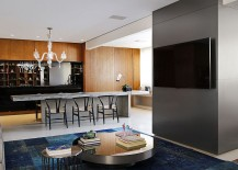 Minimal-living-area-with-splashes-of-bright-colors-and-a-wooden-wall-217x155