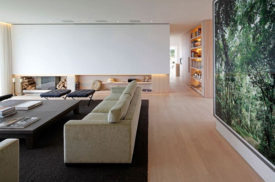 Minimal living space of the chic German home with sleek fireplace