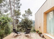 Minimal wooden deck of Casa LLP with a view of Collserola mount