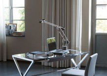 Modern-desk-with-glass-top-and-polished-steel-frame-217x155
