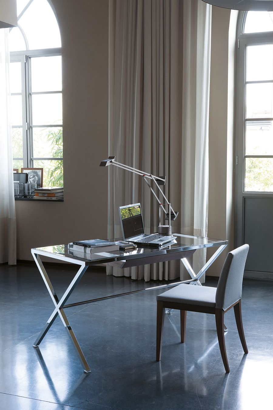 Modern desk with glass top and polished steel frame