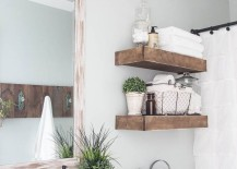 Modern-farmhouse-bathroom-with-rustic-wood-shelving-above-toilet-217x155