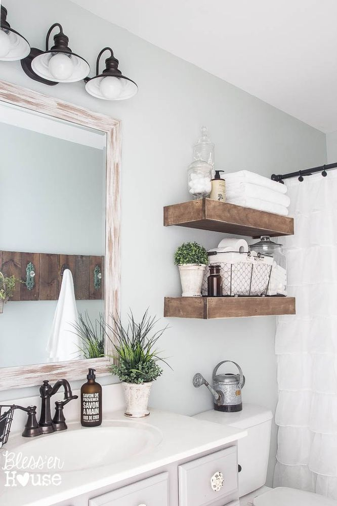 View In Gallery Modern Farmhouse Bathroom With Rustic Wood Shelving Above Toilet