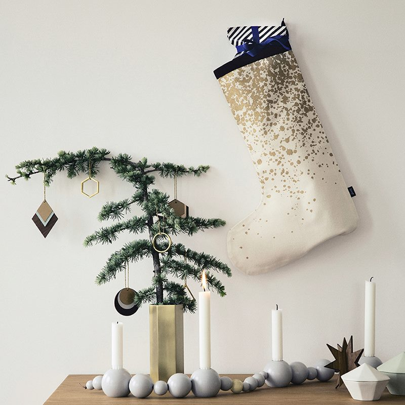 Modern gold Christmas stocking from ferm LIVING