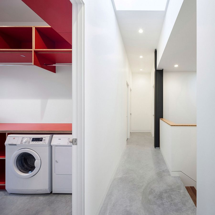 Modern minimal laundry room with a dash of red