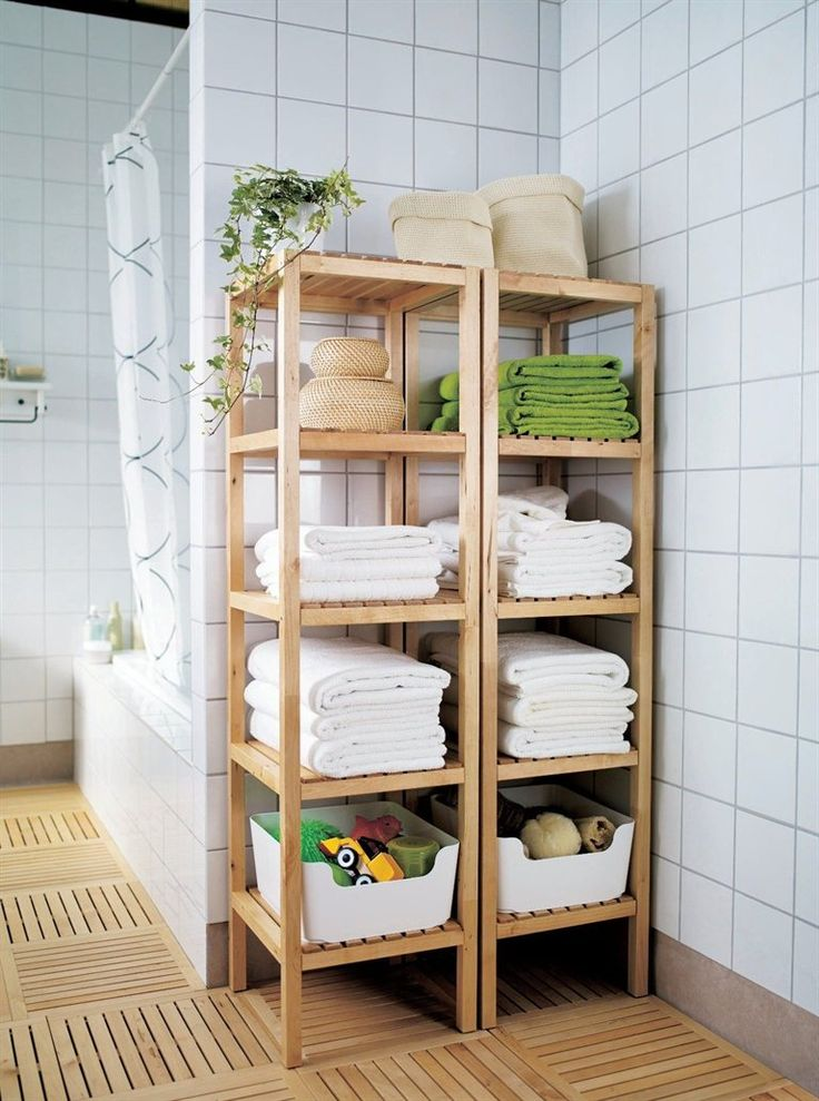 Molger open closets from IKEA that match the bathroom floor