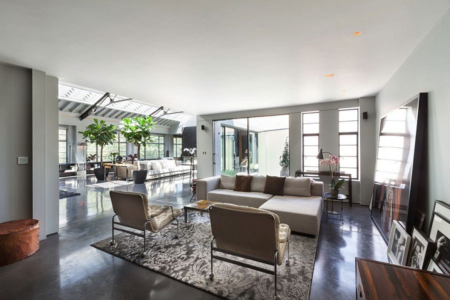 Natural light and double-height living area offer a stunning and cheerful living environment