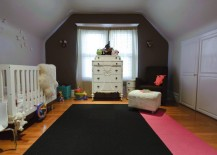 Nursery rug with a pink stripe