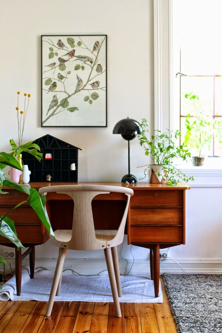 Office space with several plants and plant-inspired wall art