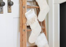 Old-painters-ladder-used-to-hold-Christmas-stockings-217x155