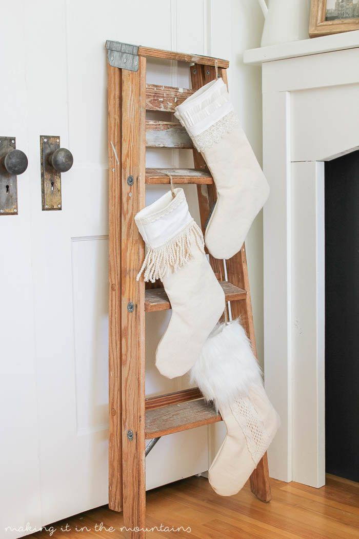 Old painter's ladder used to hold Christmas stockings