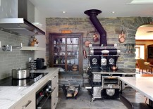 Old world charm brought to modern rustic kitchen with stone wall
