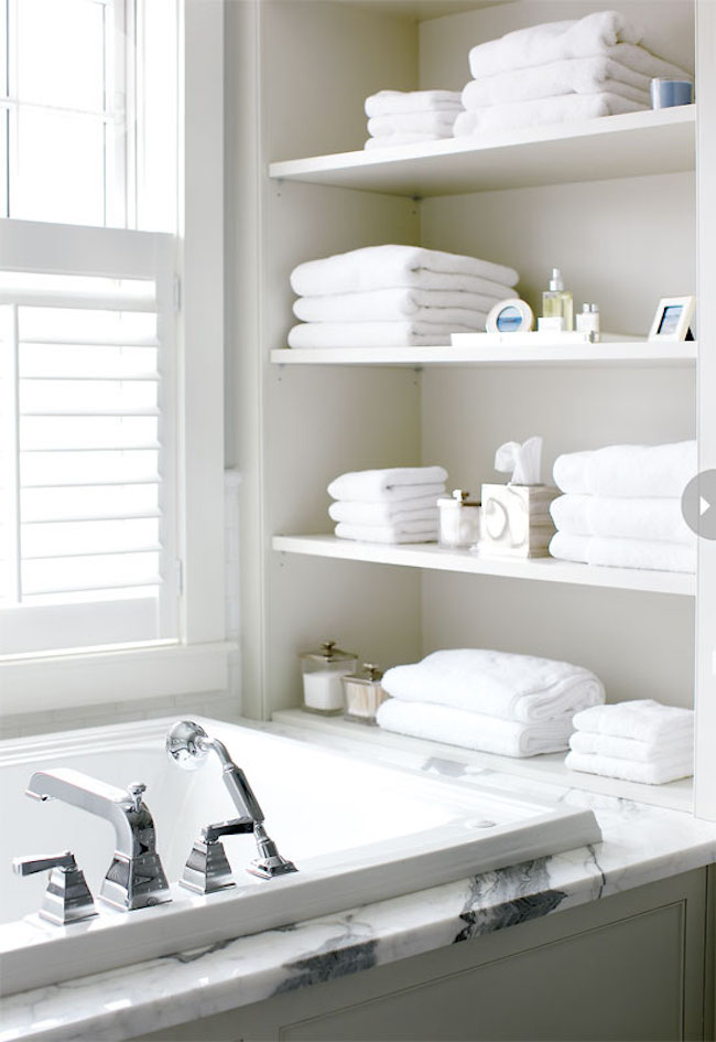 ... Open Shelving At End Of Bathtub In White, Chic Bathroom