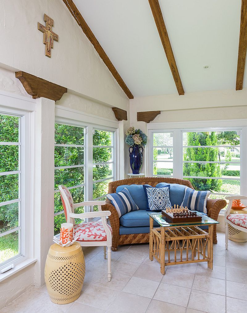 Original wooden beams of the house and custom decor steal the show in the small sunroom [Design: Margaux Interiors]