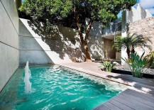 Outdoor private courtyard with pool and a small wooden deck
