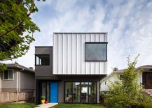 Painted front door in blue adds color to the gray and white exterior of the Vancouver home 217x155 Grade House in East Vancouver Delivers Clean, Affordable Design