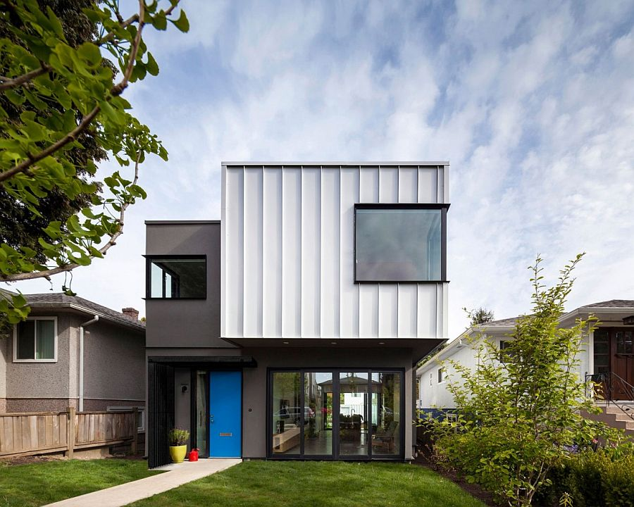Painted front door in blue adds color to the gray and white exterior of the Vancouver home