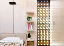 Perforated-wooden-frame-brings-light-into-the-contemporary-bedroom-217x155