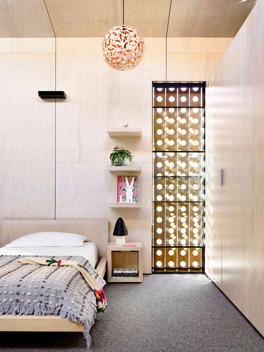 Perforated wooden frame brings light into the contemporary bedroom