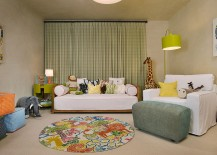 Plastered walls create a neutral backdrop as decor adds color to this playroom with daybed