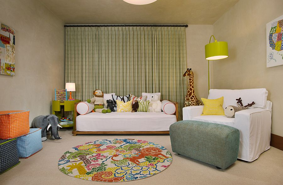 Plastered walls create a neutral backdrop as decor adds color to this playroom with daybed [Design: Poss Architecture]
