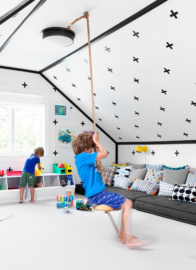 Playroom has a relaxed, contemporary vibe despite the wall decals [Design: Chango & Co.]
