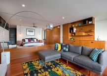 Plush-couch-for-the-bedroom-sitting-zone-with-pops-of-yellow-brought-in-by-the-rug-and-accent-pillows-217x155