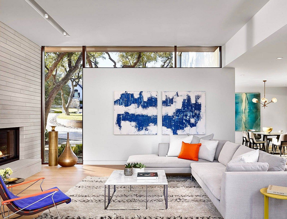 Plush couch in white, colorful wall art and chairs for the smart Texas living room