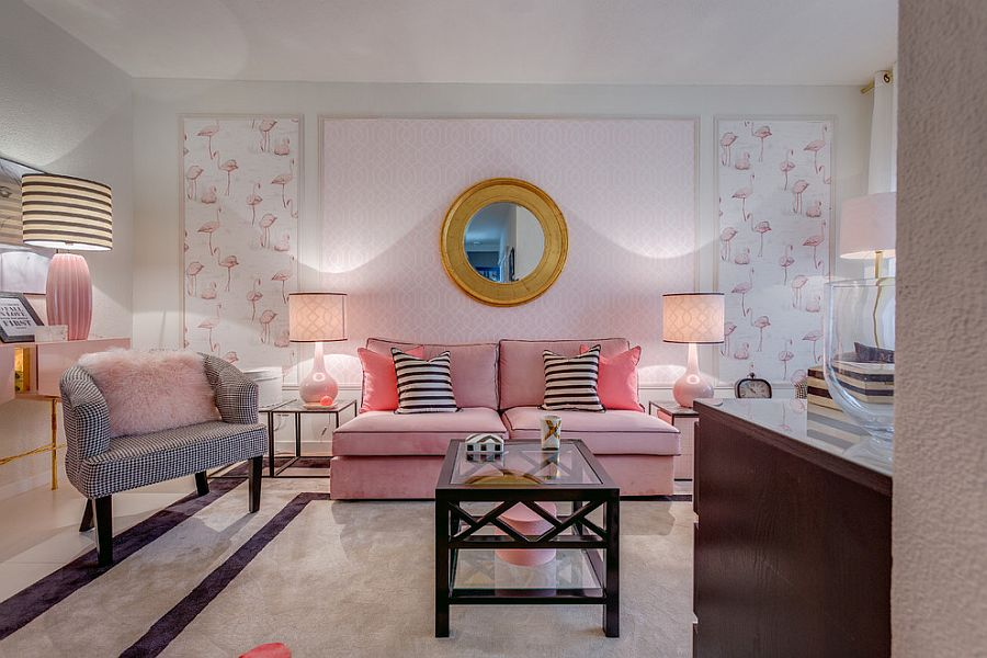 Plush couch, lamps and fuzzy pillow add an undeniable pink hue to the cozy living room