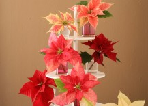 Poinsettias in different shades displayed on a tiered tray 217x155 17 Lovely Ways to Display Poinsettias for the Holidays